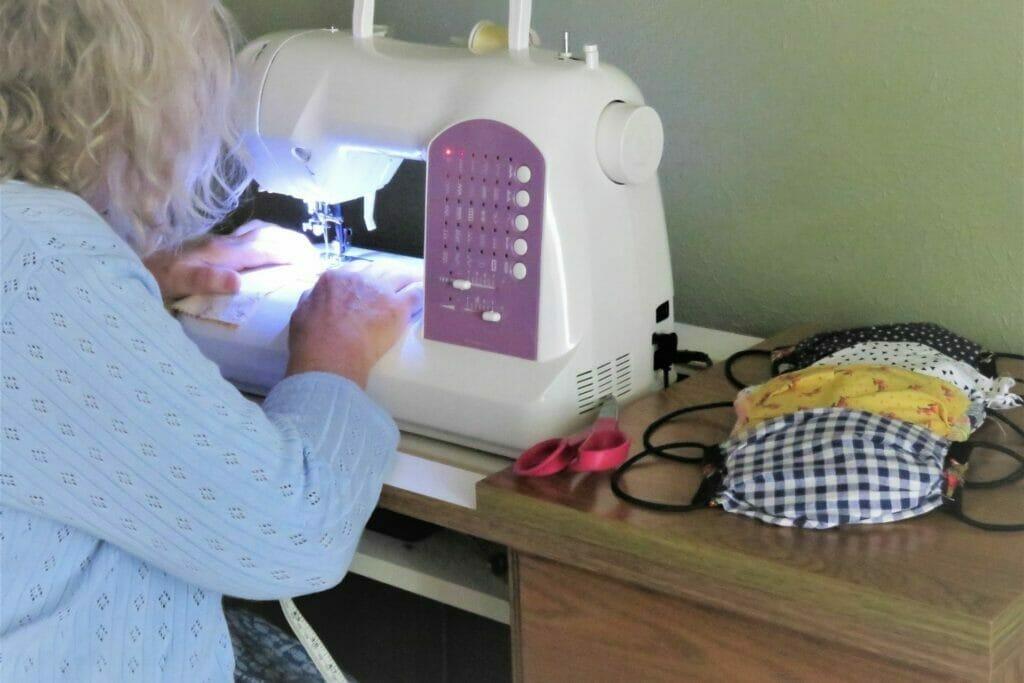 Senior sewing masks during COVID-19