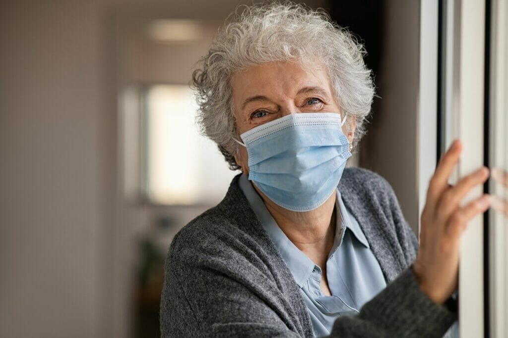 Grateful senior wearing a mask during COVID-19